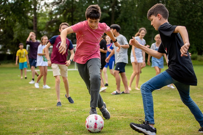 Junior summer students playing football
