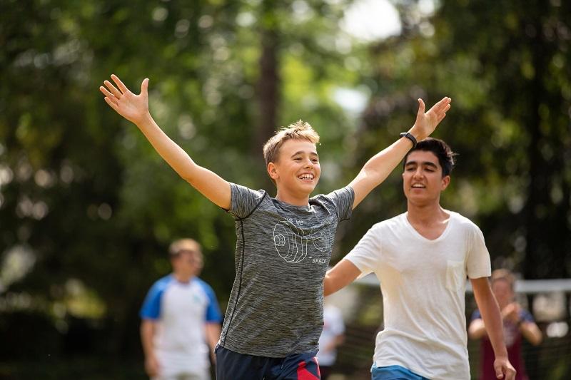 Junior student celebrating a goal