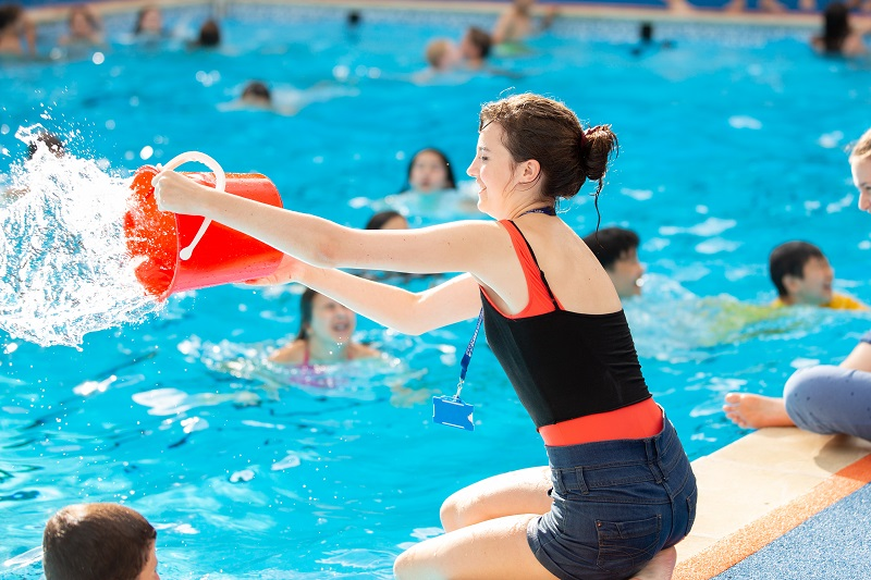 Activities staff throwing water in pool