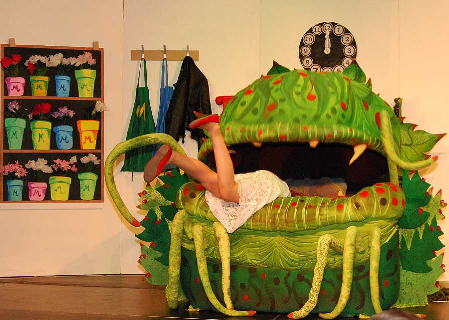 girl falling into a monster on stage