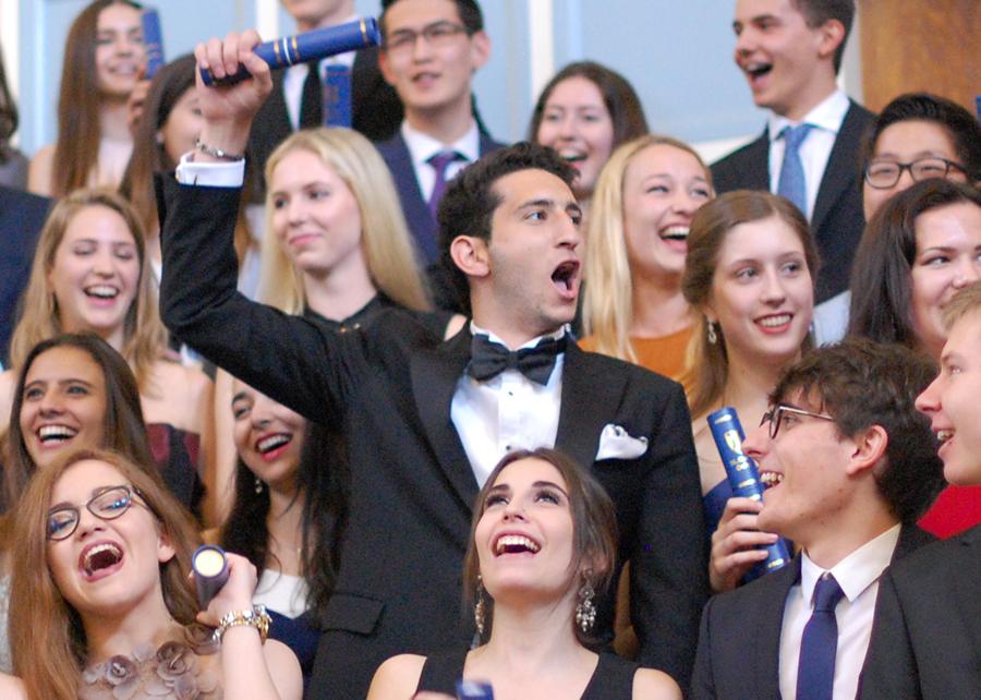 Students celebrate gaining their IB diploma.