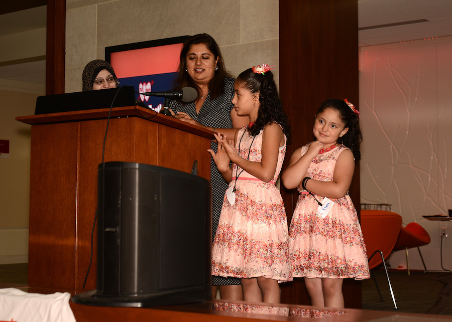 Syrian children singing during Opening Reception