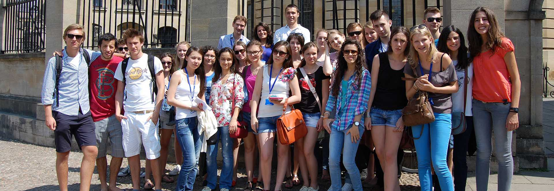 Students from St Clare's Oxford in front of the steps of the Sheldonian